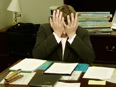 http://en.wikipedia.org/wiki/Occupational_stress#mediaviewer/File:Frustrated_man_at_a_desk_%28cropped%29.jpg